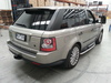 slightly off center shot of Range Rover Sport with towing mirrors